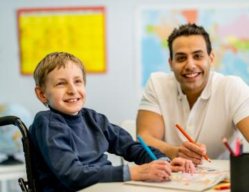 Student and teacher smiling in classroom