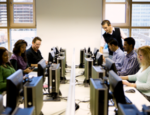 Adults working together in a computer lab