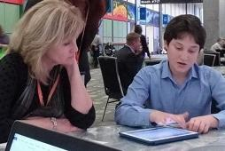 Teen demonstrating use of Bookshare to his educators