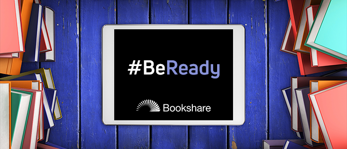 "Tablet with text ""Be Ready"" and Bookshare logo with stack of printed books"