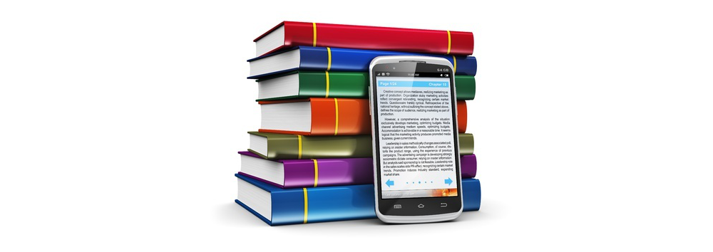stack of books with smart phone in front