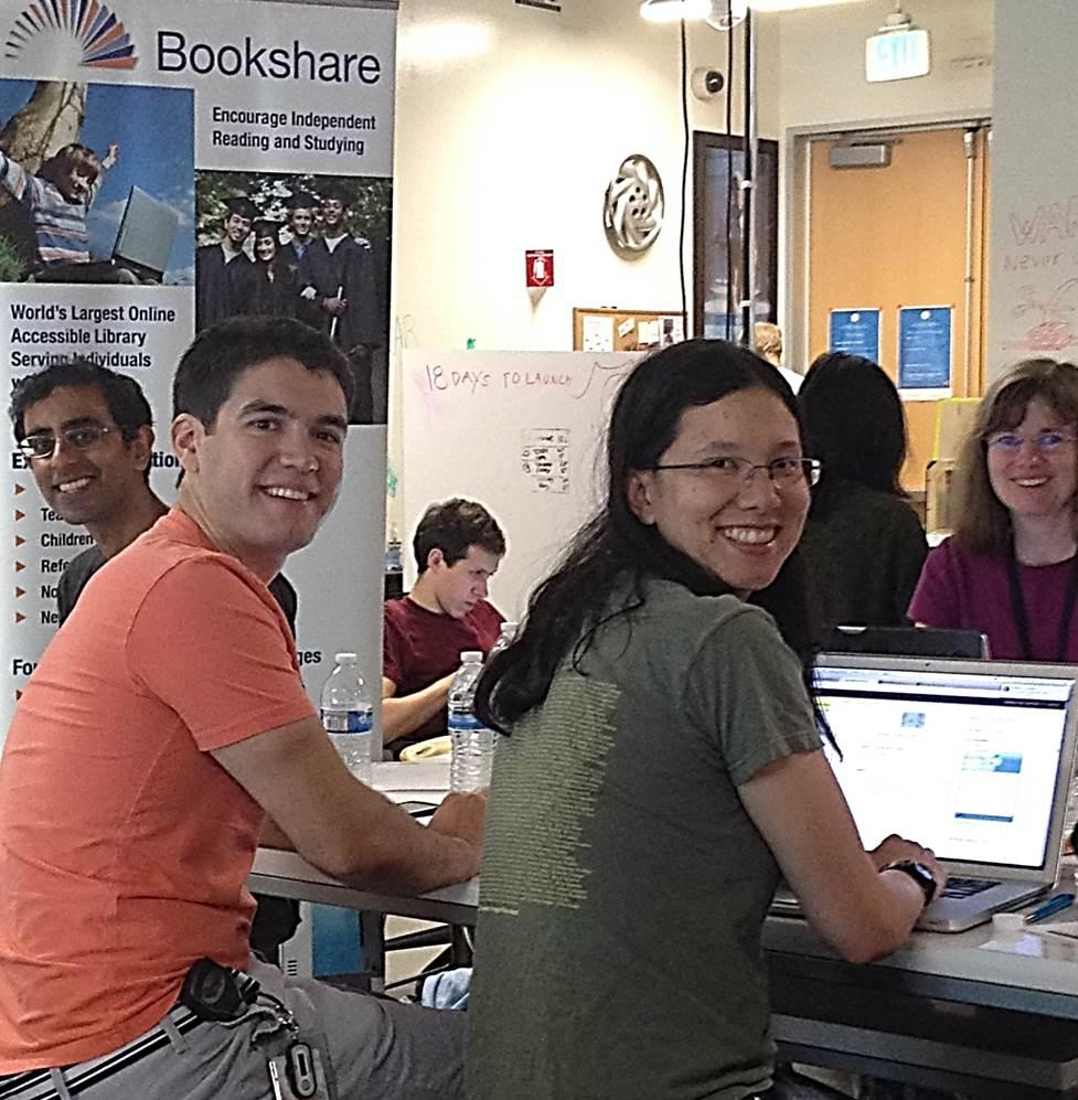 Google employees gathered around a table working on image descriptions at a Bookshare Image slam.