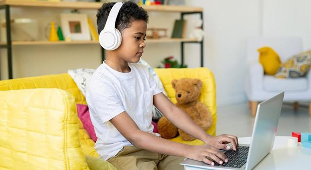 Student learning from home using laptop.