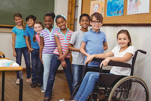 students lined up in classroom including student in wheelchair