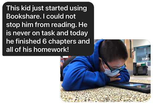 Boy wearing mask reading ebook on the floor with message from teacher saying he finished all his homework.